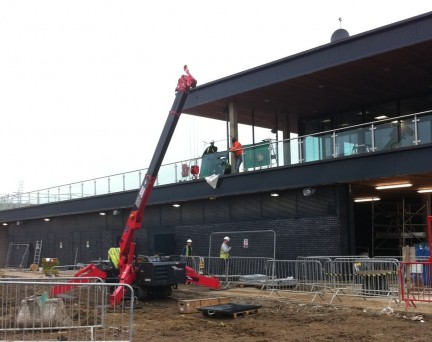 GGR's Unic Spider Crane installing glass and handrails at White Water centre.