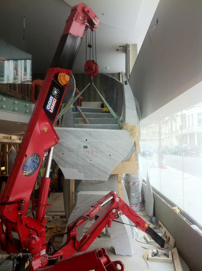 Unic 295 mini spider crane lifting marble at St James Theatre