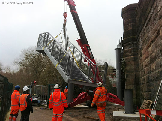 UNIC mini crane lifting staircase at Chester railway bridge