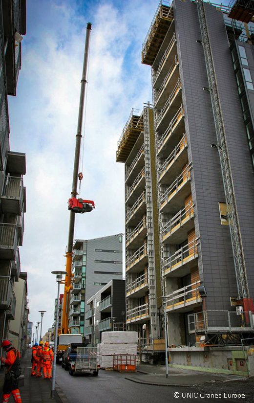 UNIC mini crane lifted 30 metres in air by mobile crane