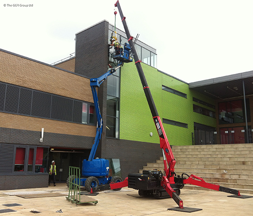 UNIC mini crane installs glazing at school