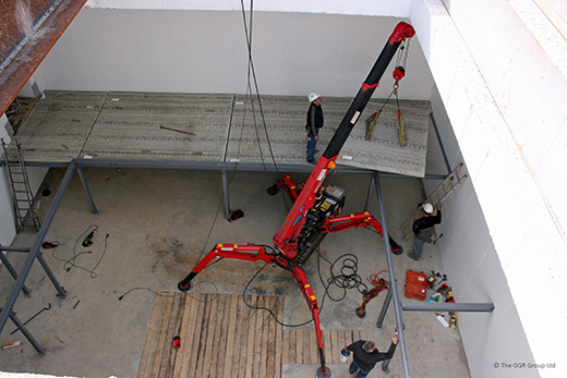 2.9t mini crane lifts concrete panels in underground bunker