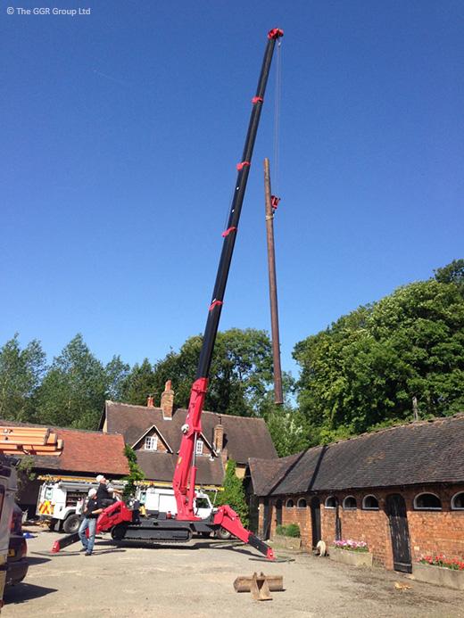 UNIC URW-706 replacing wooden power line post