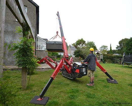 UNIC mini crane lifting hot tub