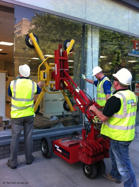 Geko glazing robot installs glass at Liverpool Tesco Express