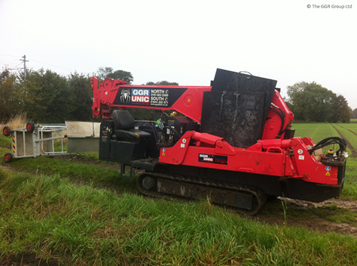 UNIC spider crane being tracked across farmers field