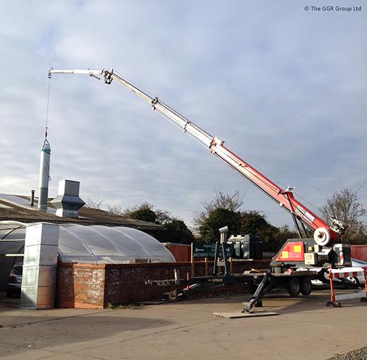 Starworker trailer crane installing chimney