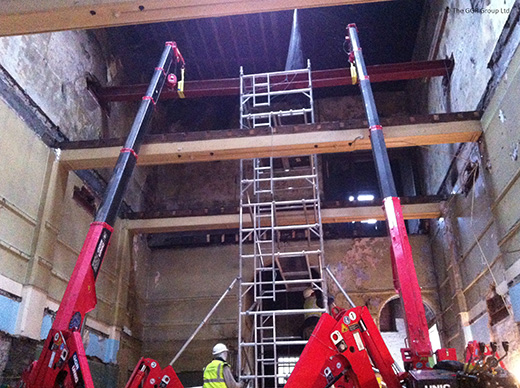 Pair of UNIC mini cranes installing steelwork