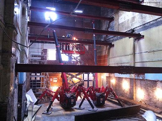 Two UNIC URW-095 cranes renovating building