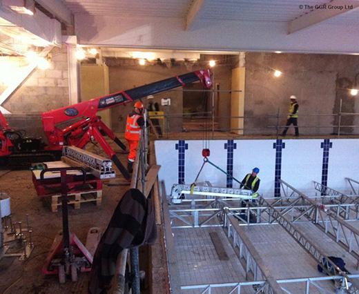 UNIC mini crane installing adjustable swimming pool floor
