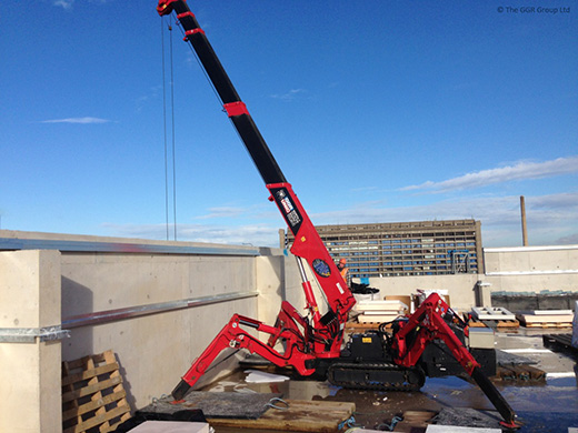 UNIC mini crane working on rooftop
