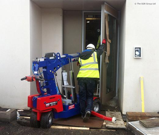 Oscar glazing robot installing blast proof doors