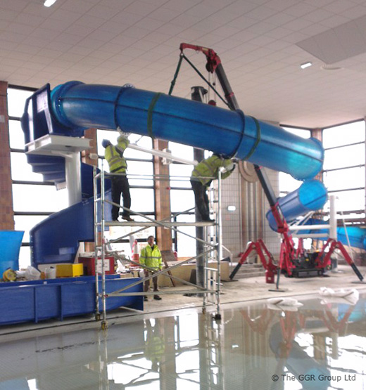UNIC mini crane working next to swimming pool