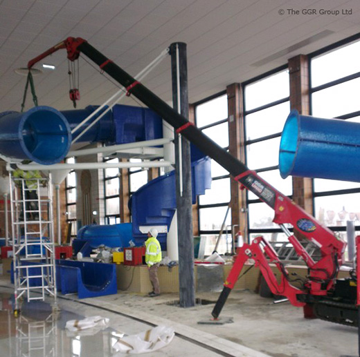UNIC mini crane installing swimming pool slide