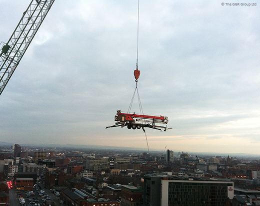 Starworker trailer crane being lifted by a tower crane