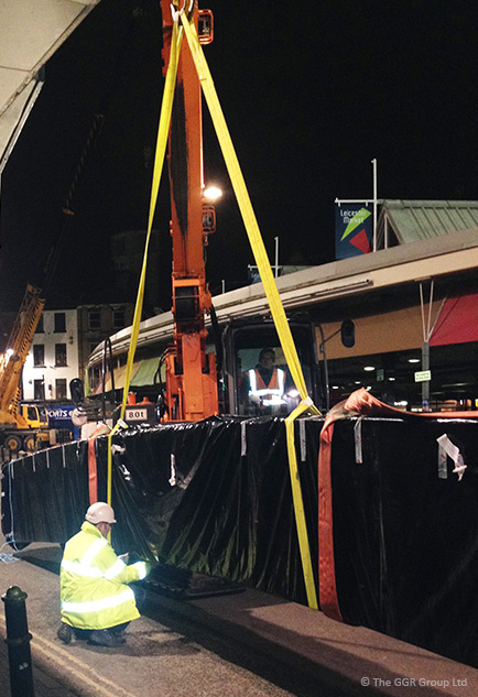 Mini crawler crane lifting beams at Leicester Market