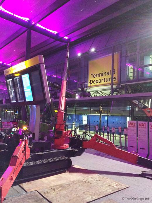 UNIC URW-506 lifting steel beams at Heathrow airport