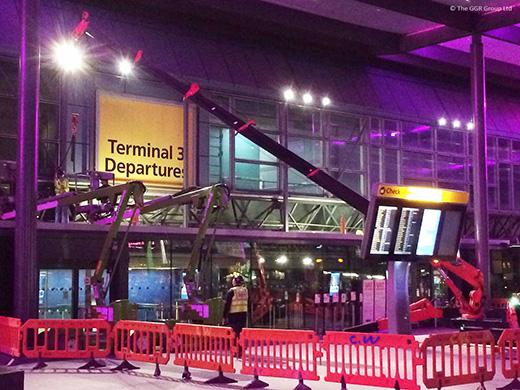 UNIC mini spider crane working inside Heathrow Terminal 3 departures