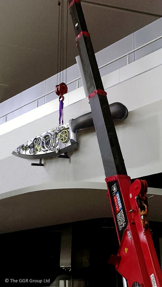 UNIC mini crane lifting clockwork knife sculpture