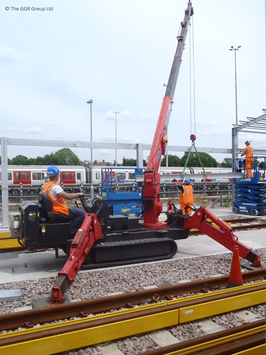 UNIC URW-376 lifting steel beams at Neasden depot