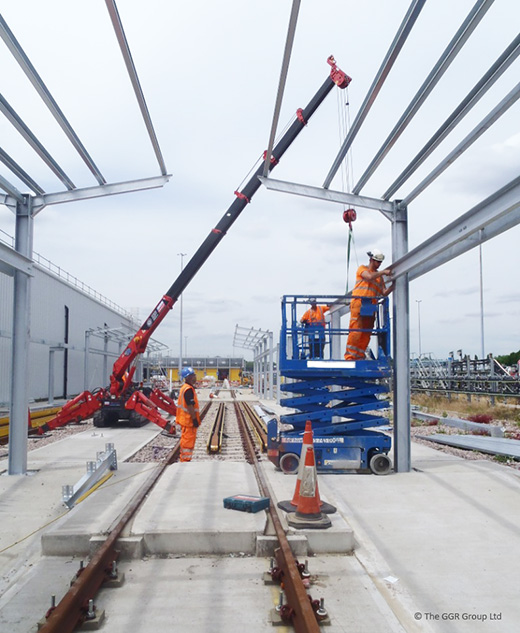 UNIC mini crane installing steelwork at rail depot