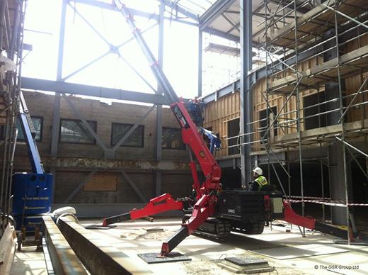 Mini crane lifting steelwork at college in York