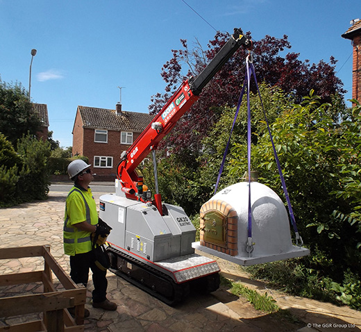 GK20 pick and carry crane installing a pizza oven