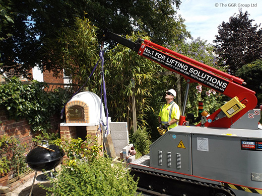 Pizza oven lifted onto stand by a GK20 crane