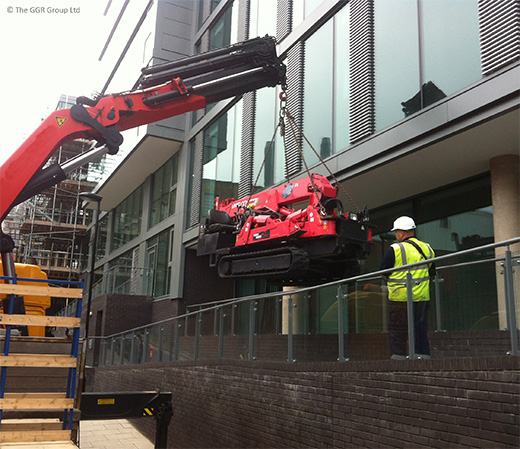 UNIC mini crane being lifted onto walkway