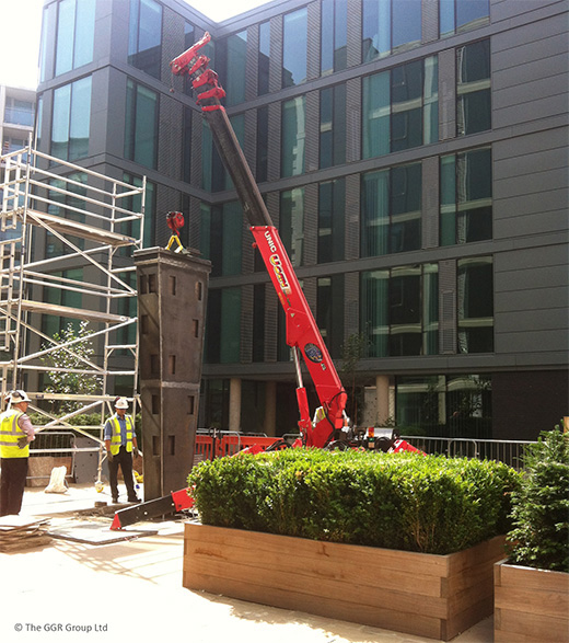 UNIC URW-376 crane erecting statue in Sheffield