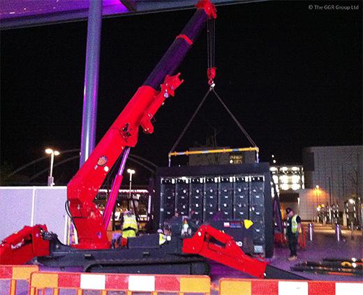 UNIC URW-706 mini crane installing digital screen