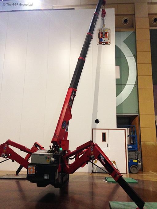 Mini Clad and UNIC crane installing hoarding panels