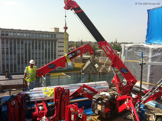 UNIC mini crane dismantled and rebuilt on rooftop