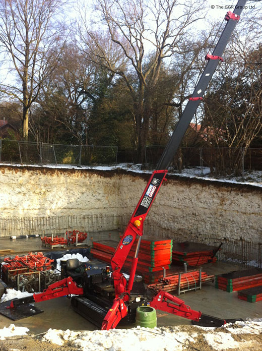 UNIC crane installing formwork for new build home