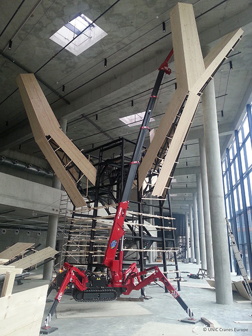 UNIC mini crane installs tree exhibit at science museum