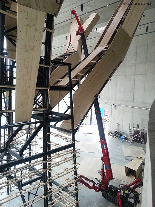 UNIC URW-095 mini crane works at Czech Republic science museum