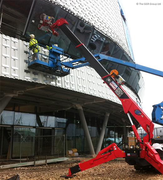 UNIC mini spider crane installs glazing at Derby velodrome