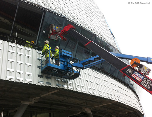 UNIC crane and GL-UMC600 install angled glazing at velodrome