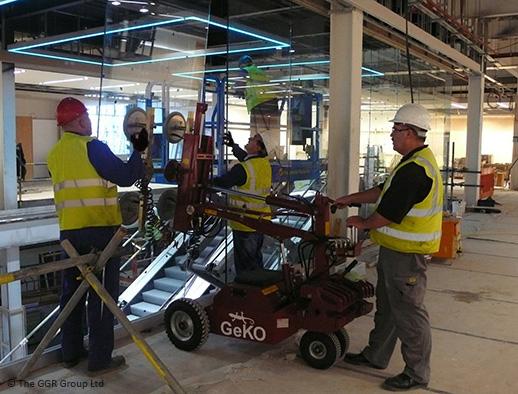 Geko robot fitting internal glazing at Primark store
