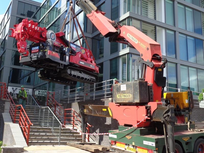 UNIC URW-1006 mini crane installing a staircase