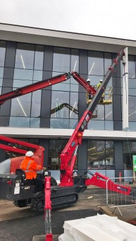UNIC URW-376 helping install sunscreen panels in London